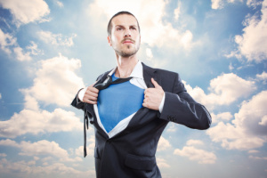 Young businessman acting like a super hero
