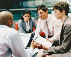 Business People Sitting in an Office Building Having a Meeting
